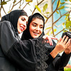 Two Arab Business Women Checking on their Photos on a professional Camera