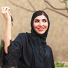 An Emirati woman is holding a car key in hand in Dubai, United Arab Emirates.
