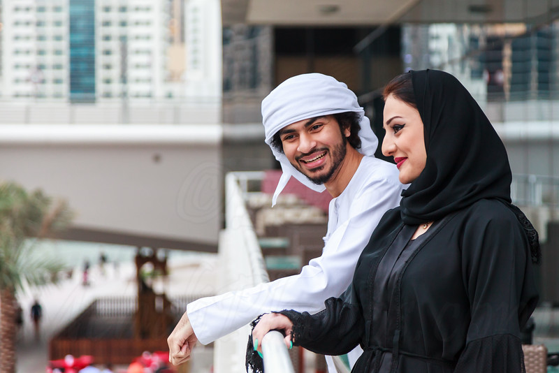 Young Emirati couple talking outdoor, Dubai, UAE