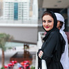 Young Emirati couple talking outdoor, Dubai, UAE
