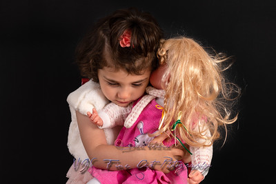 Cute Little Girl and Doll