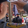 Record-Eagle/Douglas Tesner<br /> <br /> Capt. Stephen Morgan of the Traverse City Police Department salutes as the American Flag is raised during Peace Officers' Memorial Day Ceremony at the Governmental Center in Traverse City.