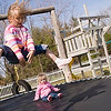 Record-Eagle/Douglas Tesner<br /> <br /> Kim Brock watches  her two grandchildren, Angelina, 5, Sydne', 2, play on a trampoline after picking them up from day care.  Brock  has been temporary guardian of her two granddaughters for a year.