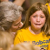 Record-Eagle/Douglas Tesner<br /> <br /> Lauren Davenport, 8, is comforted by his second grade teacher, Marcia Grassa during the closing assembly in the gym at Bertha Vos Elementary School in Acme.  The school is just one of three closed by TCAPS.