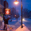 Record-Eagle/Jan-Michael Stump<br /> <br /> Blake Bartel shovels snow outside of Higgins Store on a snowy evening in Alden.