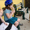Record-Eagle/Douglas Tesner<br /> <br /> Sisters Katrina, 8, and Kacie Salon, 7, enjoy Bardon's ice cream as their Old English bulldog, Riley, looks on.  One of the true signs of spring in Traverse City is the opening of Bardon's.