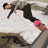 "Record-Eagle/Douglas Tesner<br /> <br /> Cosmo Boon enjoys the sunshine as he works his moves on a small area not covered by snow at the Grand Traverse Civic Center Skate Board Park Monday. ""It's a nice day out here today. A little cool but still a nice day,"" said Boon."
