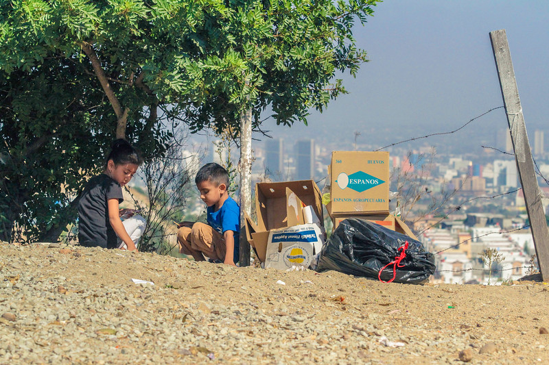 John Chaides<br /> Two kids play near a pile of trash at the Colonia Grupo Clinic by Healing Hearts Across Borders in Tijuana, Mexico on Friday, August 11, 2017.