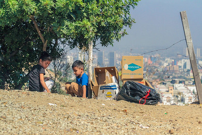 John Chaides Two kids play near a pile of trash at the Colonia Grupo Clinic by Healing Hearts Across Borders in Tijuana, Mexico on Friday, August 11, 2017.