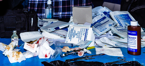 """John Chaides<br /> Used gauze pads and medical tools lie on a table at the """"El Dumpe"""" Clinic run by Healing Hearts Across Borders (HHAB) in Nueva Aurora Sur Tijuana, Mexico on Saturday, June 1, 2019. The tools were used to remove an abscess that migrated in between the patient's knee joints and was causing serious pain."""
