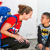 John Chaides<br /> Simone Yassear, from San Deigo, laughs with a child at the Colonia Grupo Clinic by Healing Hearts Across Borders in Tijuana, Mexico on Friday, November 10, 2017.