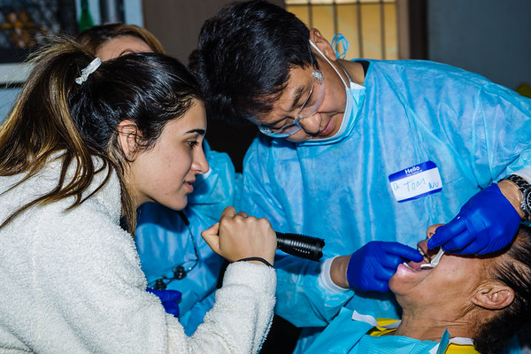 John Chaides<br /> Tom Wu, a dental hygienist, cleans and checks a patient's teeth at the Colonia Grupo Clinic by Healing Hearts Across Borders in Tijuana, Mexico on Friday, May 31, 2019. Dental hygienist are a popular stop at the clinics.