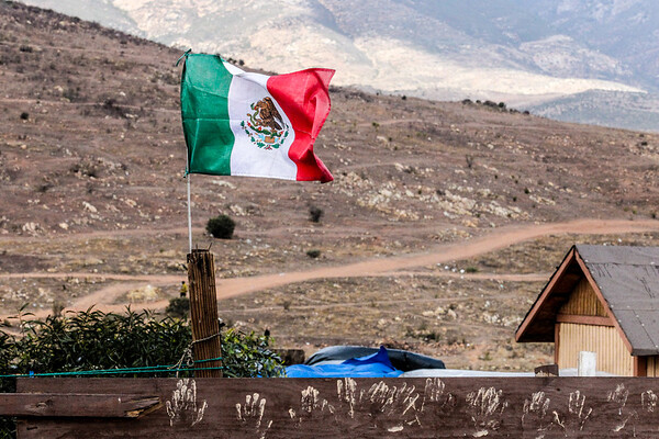 John Chaides<br /> A Mexico flag flys small poor village near the Fraccionamiento Valle de las Palmas Clinic by Healing Hearts Across Borders in Tijuana, Mexico on Friday, February 23, 2018. Many people who live in the village work at the landfill near by.