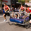Record-Eagle/Douglas Tesner<br /> The bed racing team from Brick Wheels flies down Front Street during the Bed Race at the National Cherry Festival. Brick Wheels went on to win the competition.