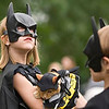 "Record-Eagle/Jan-Michael Stump<br /> Alexa Hoover, 6, left, holds her ""Bat Cat,"" Mulder, while waiting in line with her sister Callie Hoover, 5, for The National Cherry Festival Pet Show at F&M Park."