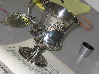 Record-Eagle/Lisa Perkins<br /> This sterling silver toasting cup from the 1850s was valued at $700, while the Chrism baptismal spoon was shown to be a reproduction.