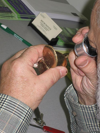 Record-Eagle/Lisa Perkins<br /> Butkovich examines the 1903 Waltham pocketwatch that belonged to Mary Sharry's grandmother.
