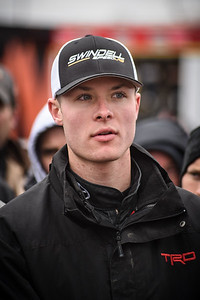 Spencer Bayston pays close attention to the drivers meeting.