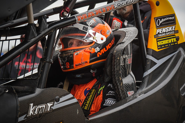 Kerry Madsen checks the wing slider of his #2 GoMuddy.com ride during heat in the motors.