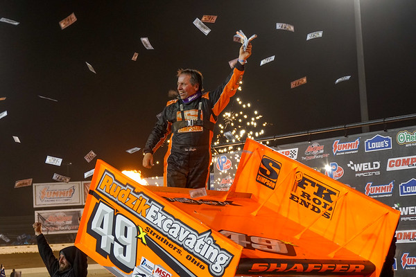 Tim Shaffer climbs from his car in victory lane.