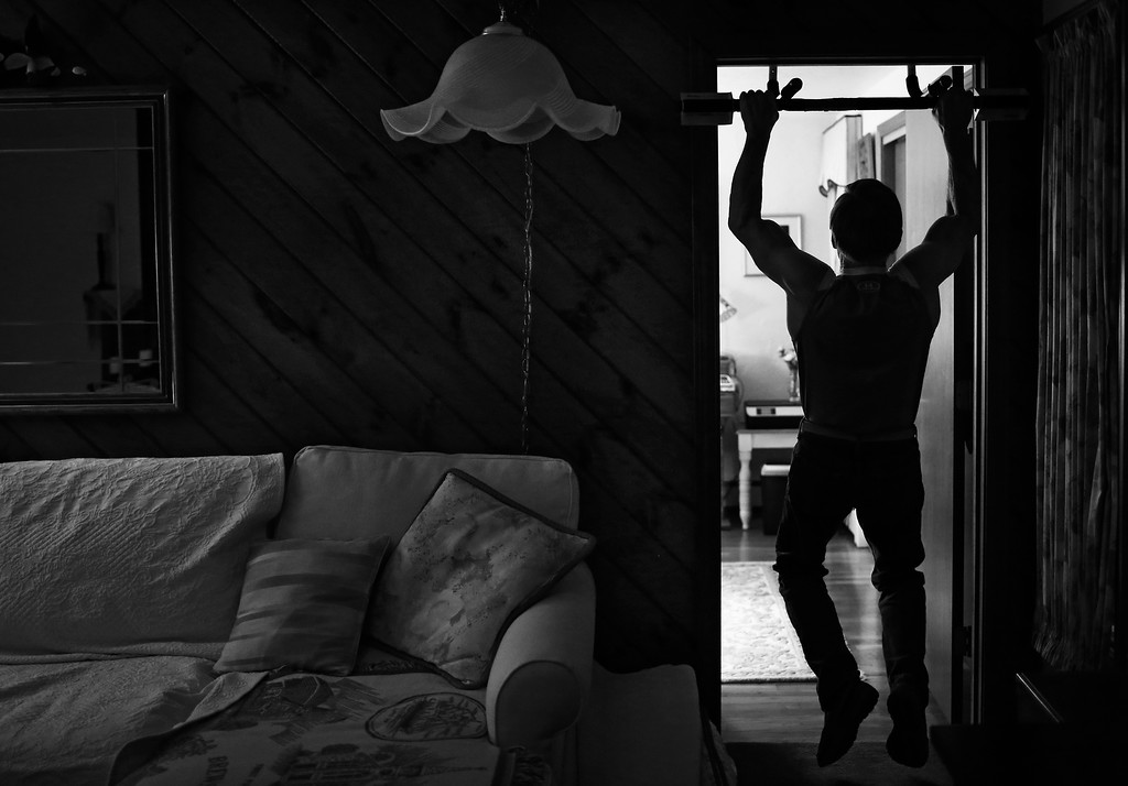 Devio's daily workout routine includes 3 sets of 10 chin ups, pull ups and press ups, which he does in his living room.