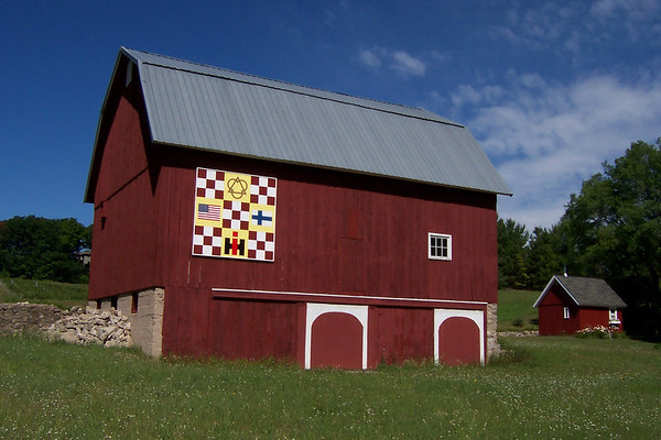 Photo courtesy of Evelyn and Carl Johnson<br /> The Finland flag and the logo for International Harvester grace this quilt square, one of two on Smokey Hollow Road in Peninsula Township.