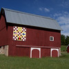 Barn Quilt Squares : Bright quilt squares decorate area barns — five currently installed with five more in production or planned — providing a splash of history to passerby. Barns enthusiast and township resident Evelyn Johnson is spearheading the project that both honors America's cultural heritage as well as lures people to explore the Old Mission Peninsula.