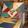 Special to the Record-Eagle/Carol South<br /> Evelyn Johnson conceived of and recruited ten families for a Quilt Barn Trail on the Old Mission Peninsula. She is pictured with two oversized squares in progress. While the five completed quilt square projects were spearheaded by the barn owners, Johnson, her husband, Carl, and volunteers are helping create the remaining five.