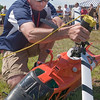 Record-Eagle/Douglas Tesner<br /> <br /> Rich Schultz, a member of the U.S. Coast Guard stationed Traverse City starts his HH-65 Dolphin helicopter.  The helicopter is a the type used by the Coast Guard in Traverse City and through out the country.