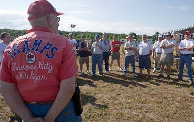 Record-Eagle/Douglas Tesner<br /> <br /> Before the air show begins at Empire Airport, Stan Hyman, holds a pilots meeting.  More than 70 pilots from across Michigan and some surrounding states took part in the Traverse Area Model Pilots Society ( T.R.A.M.P.S.) air show.