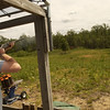 Record-Eagle/Garret Leiva<br /> Matthew Beard, 16, a Boy Scout with Troop 31 in Traverse City, fires at a clay target flying through the air at the shotgun range at Camp Greilick. While learning skills to earn a merit badge, Beard was also targeting a marksmanship award.
