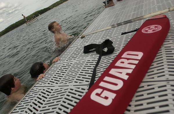 Record-Eagle/Garret Leiva<br /> Scouts make a splash at the waterfront area. Camp Greilick, located on property owned by Rotary Charities of Traverse City, has been in operation since 1923.