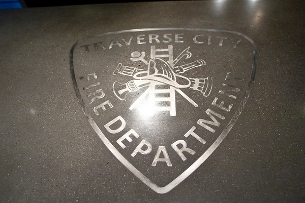 Record-Eagle/Jan-Michael Stump<br /> A concrete counter top with the Traverse City Fire Department logo in stainless steel sits in the newly remodeled kitchen of Station 2.