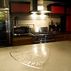 Record-Eagle/Jan-Michael Stump<br /> A concrete counter top with the Traverse City Fire Department logo in stainless steel.