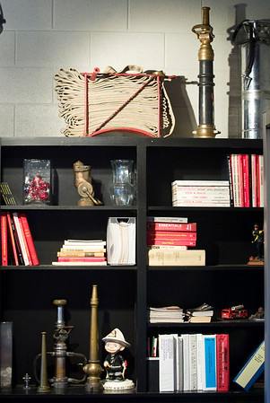 Record-Eagle/Jan-Michael Stump<br /> Books and firefighting artifacts on a bookshelf in the remodeled lounge.