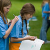 Record-Eagle/Jan-Michael Stump<br /> Fifth-graders Michala Macek, left, and Kelly Peregrine, 11, sign each other's yearbook and t-shirt during a class picnic outside Eastern Elementary on their last day of school.