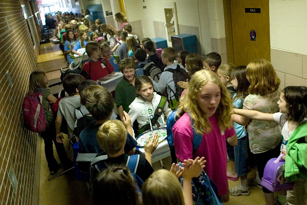 Record-Eagle/Jan-Michael Stump<br /> Fifth-grade students at Eastern Elementary walk through the hallways lined with other students, staff and parents on the last day of class, a school tradition. Fifth graders start the procession, and are followed by the lower grades.