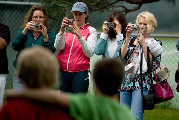 Record-Eagle/Jan-Michael Stump<br /> From left, Jill Jenkins, Jo Peregrine, Tricia Moore and Jessie Mecek take pictures of their fifth-graders during a class picnic at Eastern Elementary on their last day of school.