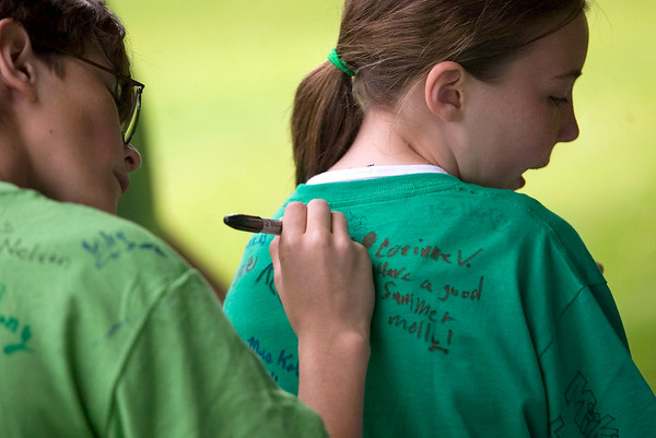 Record-Eagle/Jan-Michael Stump<br /> Fifth-grader Alex Schneider, left, signs classmate Molly Hogan's shirt during a class picnic outside Eastern Elementary on their last day of school.