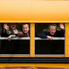 Record-Eagle/Jan-Michael Stump<br />  Eastern Elementary students wave to classmates as their bus pulls away on the last day of school.