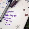 Record-Eagle/Jan-Michael Stump<br /> A yearbook signed by classmates sits in the grass during Thursday's fifth-grade picnic at Eastern Elementary School.