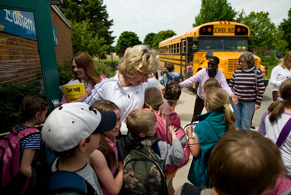 Record-Eagle/Jan-Michael Stump<br />  Eastern Elementary principal Susan Zell hugs a group of students outside school on the last day of class.