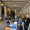 """Record-Eagle/Vanessa McCray<br /> Crew members on the film """"Fitful"""" sort through a mound of supplies and equipment stashed on board the S.S. City of Milwaukee. The cavernous ship served as the setting for writer and director Rich Brauer's latest dark comedy/ suspense film."""