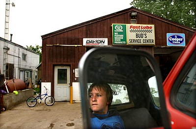 Record-Eagle/Tyler Sipe<br /> John Rosa, Jr., 12, a fourth generation member of the family-owned business Bud's in Honor, helps his dad John Rosa by lowering the bed of a tow truck. Founded in 1956, the business has struggled in recent years with the sour economy and the increase in gas prices. The family business includes a party store, automotive and towing service, and canoe and kayak services.