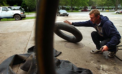 Record-Eagle/Tyler Sipe<br /> John Rosa inflates tubes for water tubing trips in Honor.