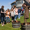 Record-Eagle/Douglas Tesner<br /> Mary Rapin, right, all most loses her balance as she and daughter Katherine Rapin, of Petoskey, stomp grapes during the annual Harvest Days at Chateau Chantal on Old Mission Peninsula.