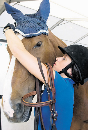 Record-Eagle/Douglas Tesner<br /> Mariola Power puts a bonnet on Tubby, her 15-year-old, 1,300-pound warmblood jumper.