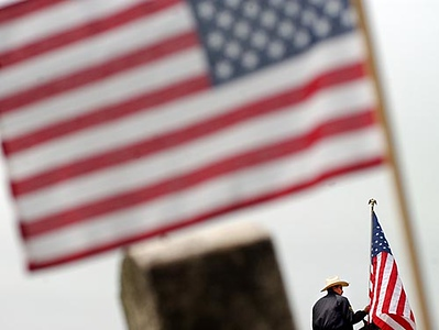 Record-Eagle/Tyler Sipe<br /> Bulmaro Moreno, a deputy with the Leelanau County Mounted Division, holds the American flag while sitting atop his quarter horse named Bandito prior to the start of Monday's Northport Community Memorial Day Service held at the Leelanau Township Cemetery.