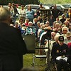 Record-Eagle/Tyler Sipe<br /> Hundreds listen to George Anderson recognize veterans during Monday's Northport Community Memorial Day Service held at the Leelanau Township Cemetery.