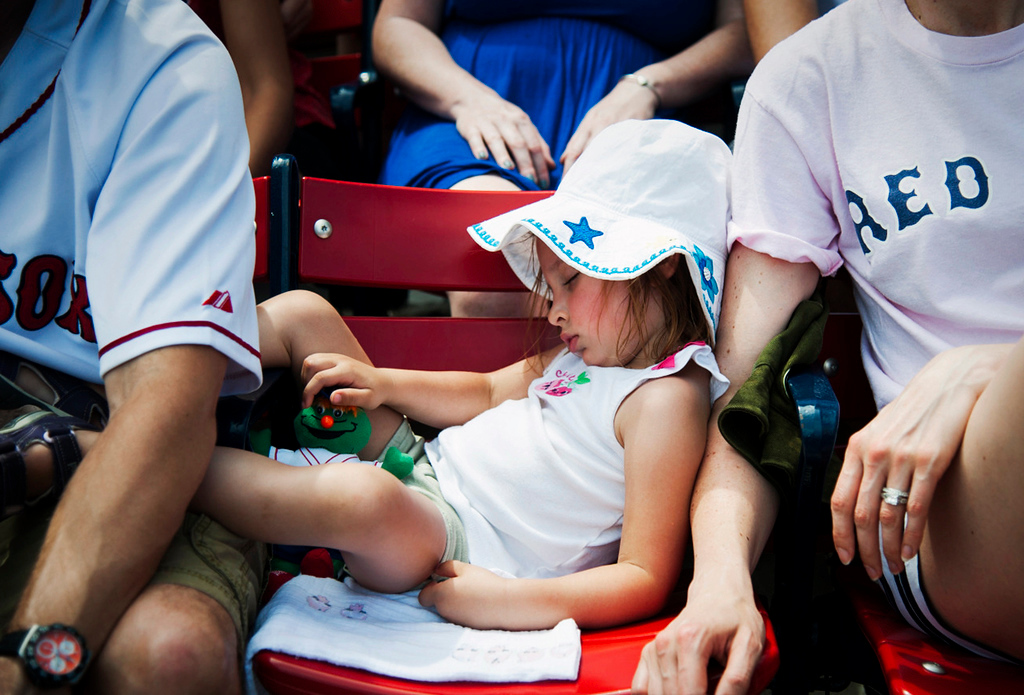 A young fan takes a nap in between innings during the game against the Toronto Blue Jays on June 13, 2015.